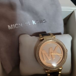 Micheal Kors gold tone watch with tourtise band